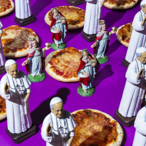 "Pope Francis/Pizza and Holy Spirit — During a recent interview Pope Francis said he didn't dislike being Pope at all, but what he really missed was his freedom. ""The only thing I'd like to do is to be able to go out one day without anyone recognizing me and go get a pizza"" he said, laughing. After this ""holy revelation"", Francis received a delicious surprise from an Italian pizzeria - a handcrafted pizza in the Vatican's colors delivered straight to his popemobile. Amen!"