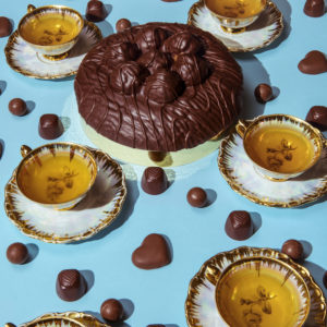 Queen Elizabeth II/  Chocolate and Tea — Queen Elizabeth knows what she likes. She only wears one nail polish shade, always carries the same purse, and famously adores a particular dog breed. So it's no surprise that she's also a stickler when it comes to the royal menu. She absolutely loves chocolate, especially chocolate biscuit cake, chocolate mousse, and chocolate ganache sponge cake, all washed down with tea. Cheers to that!
